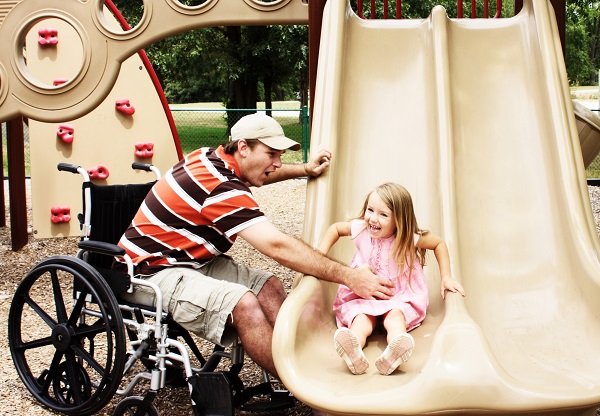 Father in Florida with multiple sclerosis playing with daughter